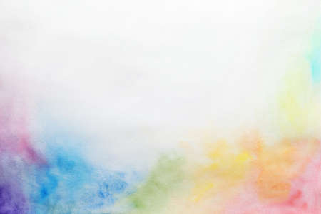 Colorful paints on white paper. Abstract background