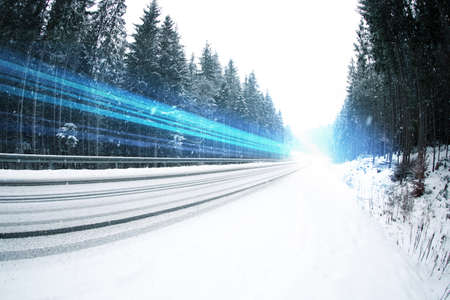 Beautiful landscape and road on snowy day. Design with light effects 스톡 콘텐츠 - 124722651