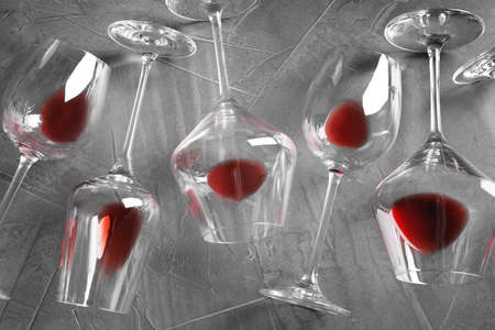 Different glasses with red wine on grey background, flat lay 스톡 콘텐츠