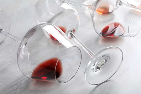 Different glasses with wine on light background, closeup Stock fotó