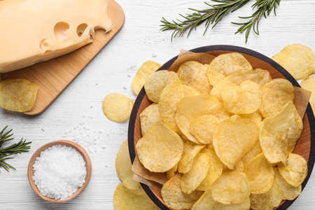 Flat lay composition with delicious crispy potato chips on table Stock Photo
