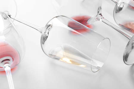 Glasses with different wine on white background, closeup