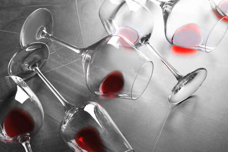 Different glasses with red wine on grey background 스톡 콘텐츠