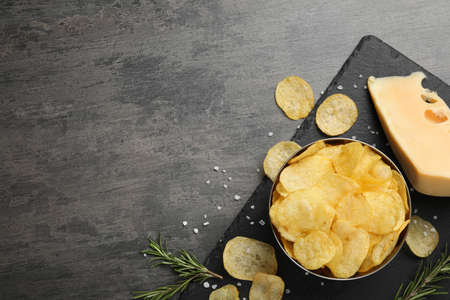 Flat lay composition with delicious crispy potato chips on table, space for text Stock Photo
