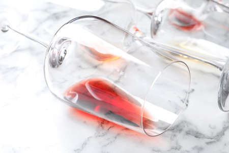 Glasses with red wine on marble background, closeup