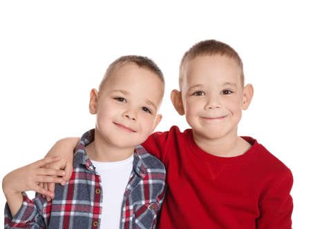 Portrait of cute twin brothers on white background Banco de Imagens