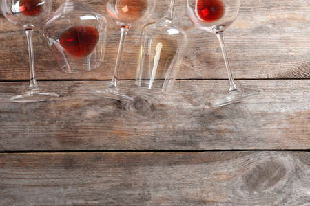 Different glasses with wine on wooden background, flat lay. Space for text 스톡 콘텐츠