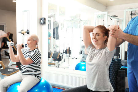 Patients exercising under physiotherapist supervision in rehabilitation center Standard-Bild