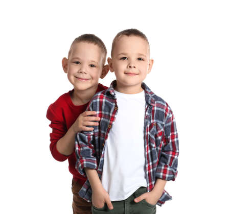 Portrait of cute twin brothers on white background Banque d'images