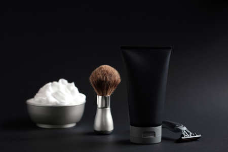 Set of shaving equipment and mens cosmetic products on black background