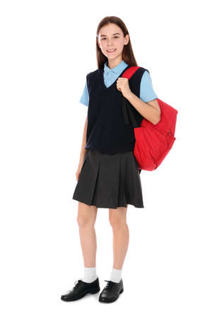 Full length portrait of teenage girl in school uniform with backpack on white background