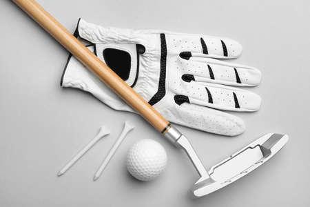 Set of golf equipment on grey background, flat lay Stock Photo