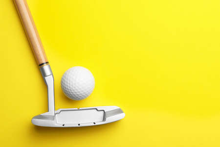 Golf ball and club on color background, flat lay. Space for text
