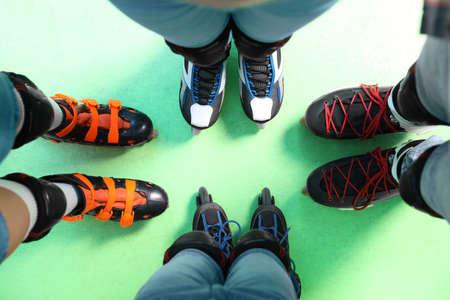 Family with roller skates on rink, top view Reklamní fotografie