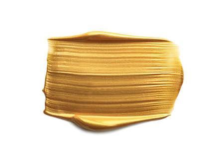 Coup de peinture dorée isolé sur blanc, vue de dessus