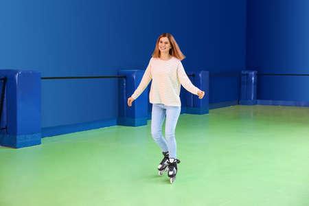 Woman having fun at roller skating rink