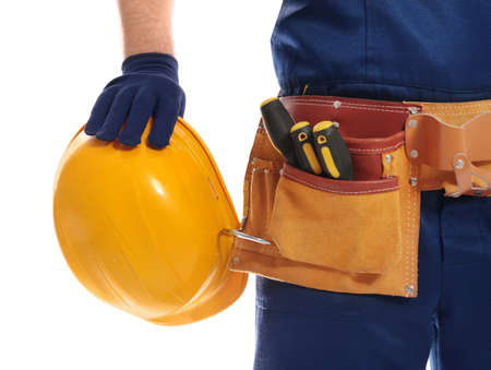 Construction worker with hard hat and tool belt on white background, closeup