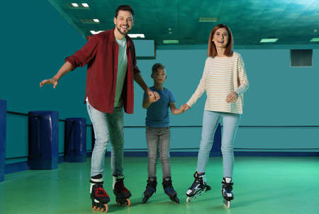Happy family having fun at roller skating rink