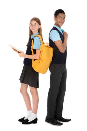 Full length portrait of teenagers in school uniform on white background
