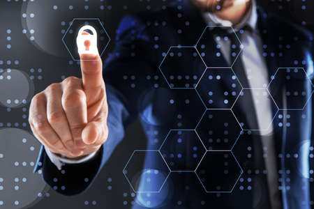 Businessman using fingerprint scanner on dark background, closeup. Digital identity