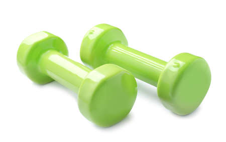 Color dumbbells on white background. Home fitness Imagens - 124878708