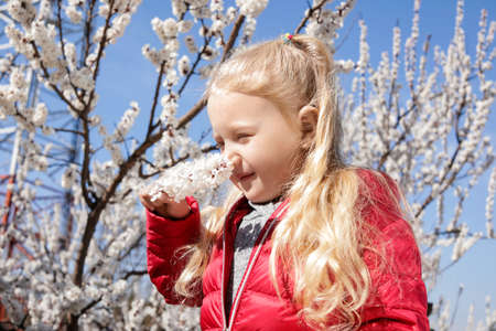 Happy healthy little girl enjoying springtime outdoors. Allergy free concept