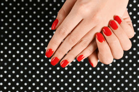 Woman showing manicured hands with red nail polish on patterned background, top view. Space for text Фото со стока - 124879030