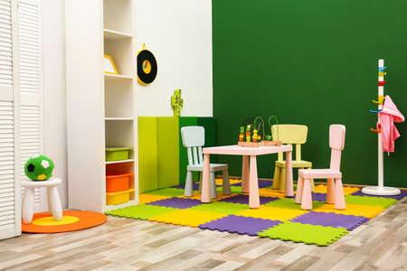 Stylish playroom interior with table and chairs Stock Photo