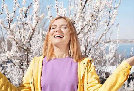 Happy healthy woman enjoying springtime outdoors. Allergy free concept Stock Photo
