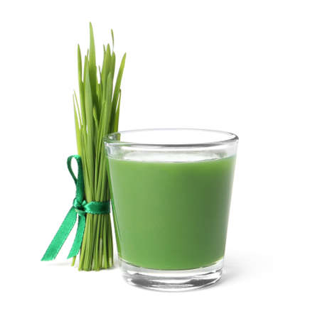 Glass of fresh wheat grass juice and sprouts on white background Stock Photo