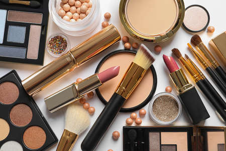 Different luxury makeup products on white background, top view Imagens