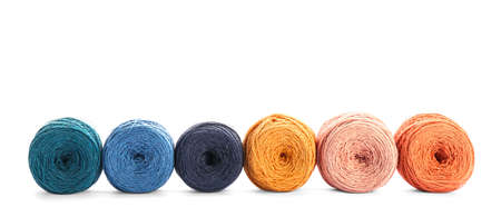 Clews of colorful knitting threads in row on white background Banco de Imagens - 124990437