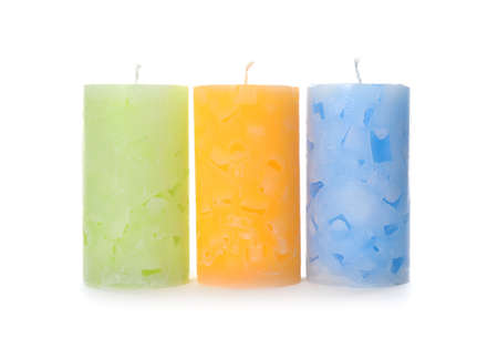 Three color wax candles on white background 写真素材