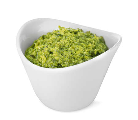 Bowl of tasty pesto sauce isolated on white Stok Fotoğraf