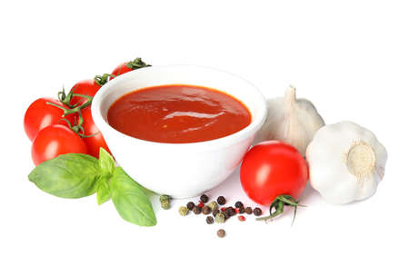 Composition with bowl of tomato sauce and vegetables isolated on white