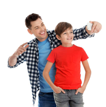 Dad and his son taking selfie on white background Stock Photo