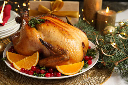 Delicious roasted turkey served for Christmas dinner on table