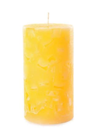 Scented color wax candle on white background
