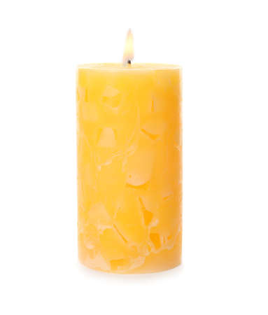 Alight color wax candle on white background