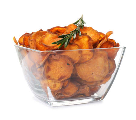 Bowl of sweet potato chips with rosemary isolated on white