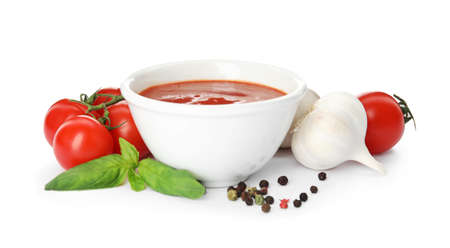 Composition with bowl of tomato sauce and vegetables isolated on white Zdjęcie Seryjne - 124997744