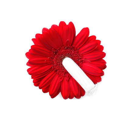 Flower and tampon on white background, top view. Gynecological care