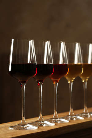 Glasses of different wines against blurred background. Expensive collection 写真素材