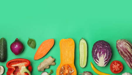 Flat lay composition with fresh ripe vegetables on color background. Space for text