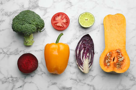 Flat lay composition with fresh ripe vegetables on marble background Banco de Imagens