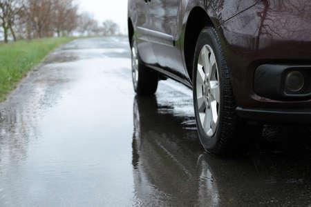 Car parked outdoors on rainy day, closeup