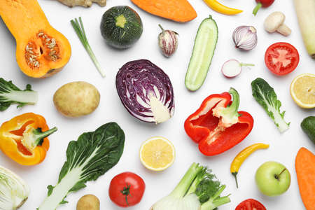 Flat lay composition with fresh ripe vegetables and fruits on white background Banco de Imagens