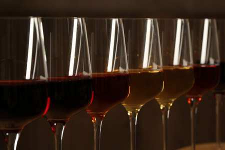Glasses of different wines against blurred background, closeup. Expensive collection 写真素材
