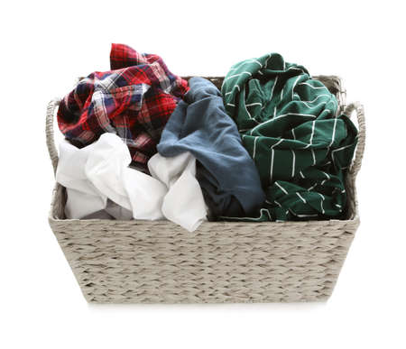 Wicker laundry basket full of dirty clothes on white background Imagens - 124961429
