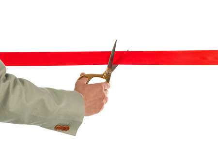 Man in office suit cutting red ribbon isolated on white, closeup